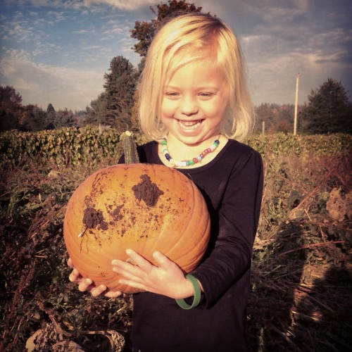 Lea is so happy about her pumpkin!