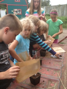 Farm Kids sowing their mystery bags of seeds.