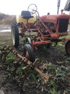 1950 Formal Cub 1. With axle spacers. Not perfect, but in good working condition. $1,500 Toolbar with four Planet Junior seeders $1,200.