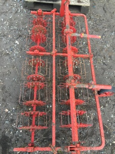 Buddingh Basket Weeder for Farmall Cub. Set up for 4 rows. $2,000