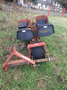 Rear view of Mechanical Transplanter. 3-point, ground-driven. $1,000